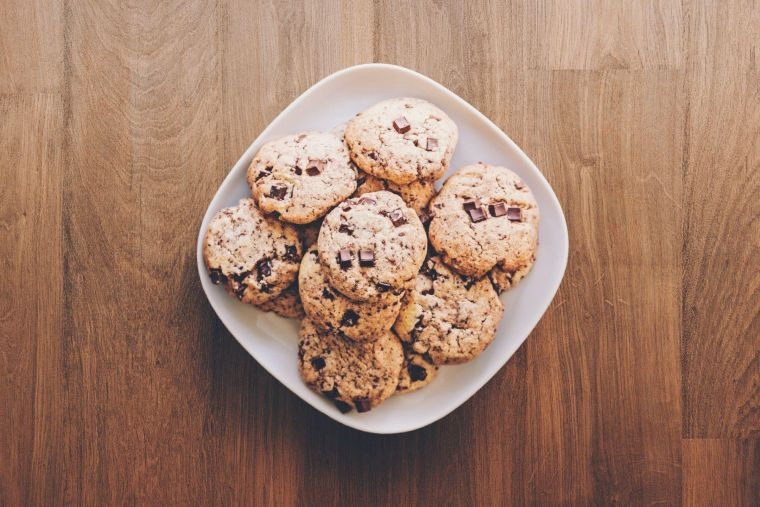 a bowl of cookies on a wooden table