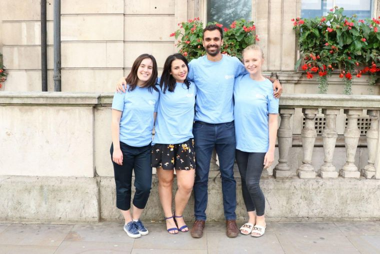 a group of four Moorfields Eye Charity volunteers wearing branded t-shirts
