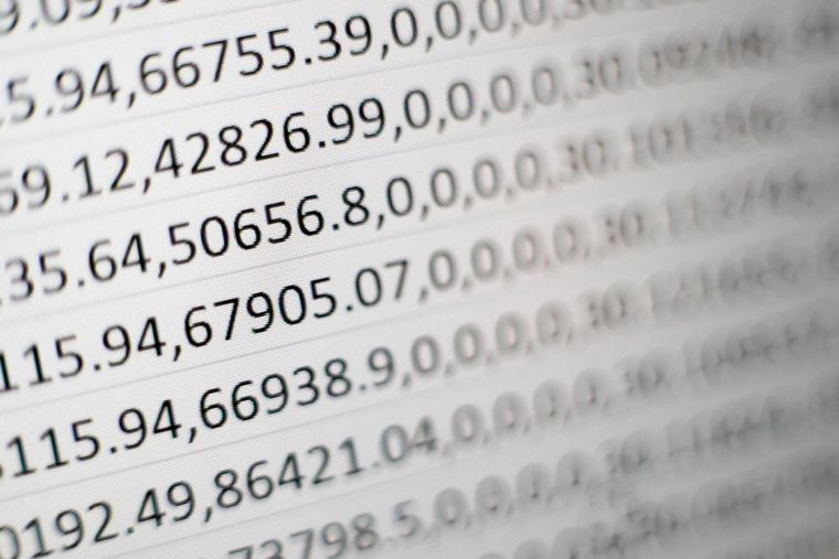 a close-up of a computer screen with long numbers stretching across it