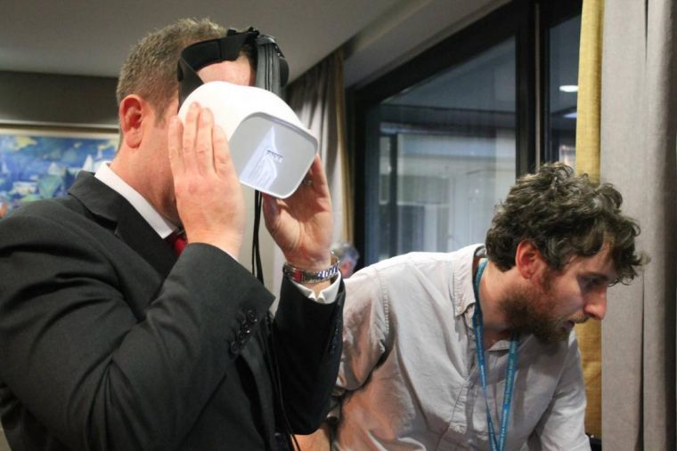 Dr Pete Jones demonstrating his research, as another person wears a VR headset and tries out the experience directly
