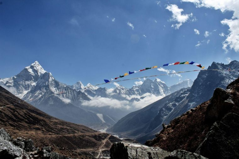 a walking route in the Himalayas, decorated with multi-coloured bunting on a sunny day